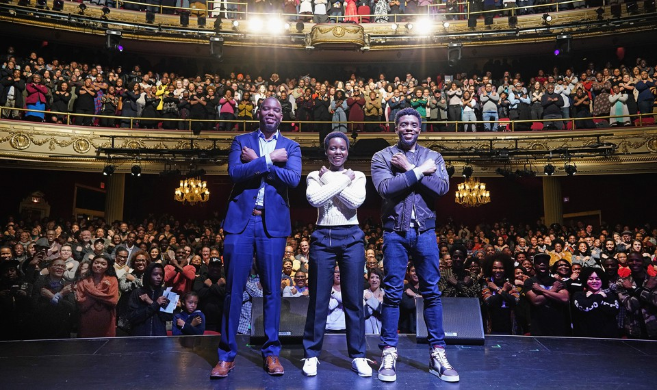 Ta-Nehisi Coates, Lupita Nyong'o, and Chadwick Boseman pose with the Apollo Theater crowd
