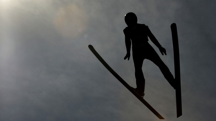 An Olympic skiier practices.
