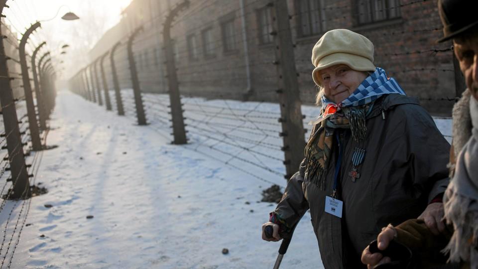 Survivors walk in Auschwitz-Birkenau in Oswiecim, Poland, in 2017.