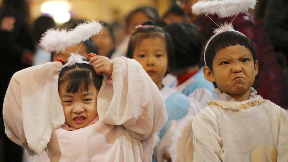 Children dressed as angels attend a Christmas mass at a Catholic church in Beijing.