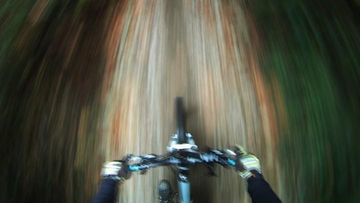 A blurry photo of a mountain bikerJonathan Hayward   AP a18eb1941