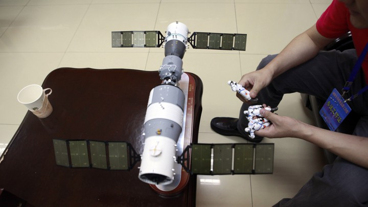 A model replica of the Tiangong-1 space station and three astronaut figures