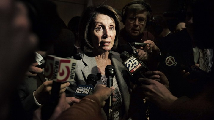 House Minority Leader Nancy Pelosi surrounded by reporters