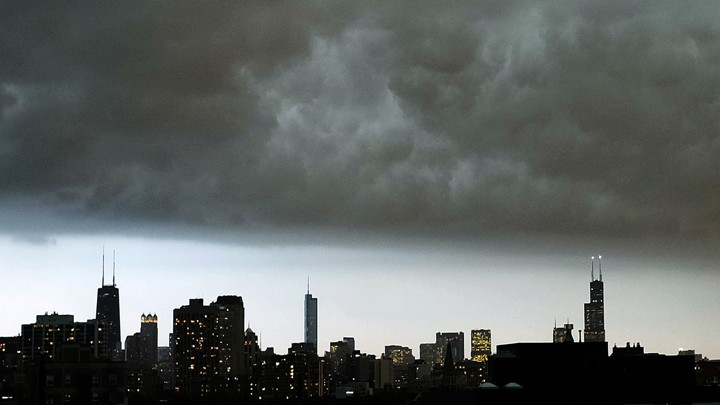 The Chicago skyline under a dark cloud