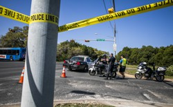 Police tape marks off a neighborhood street in Austin, Texas.