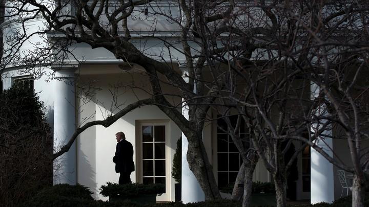 President Trump walks outside the White House.