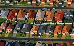 Many colorful suburban houses seen from above