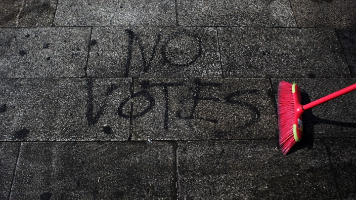 """NO VOTES"" is spray-painted on the ground."