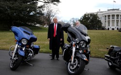 President Trump stands next to Harley Davidson motorcycles in Washington, D.C. on February 2, 2017.