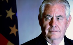 Rex Tillerson in front of an American flag