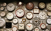Analog clocks of different designs displaying the time 1:40