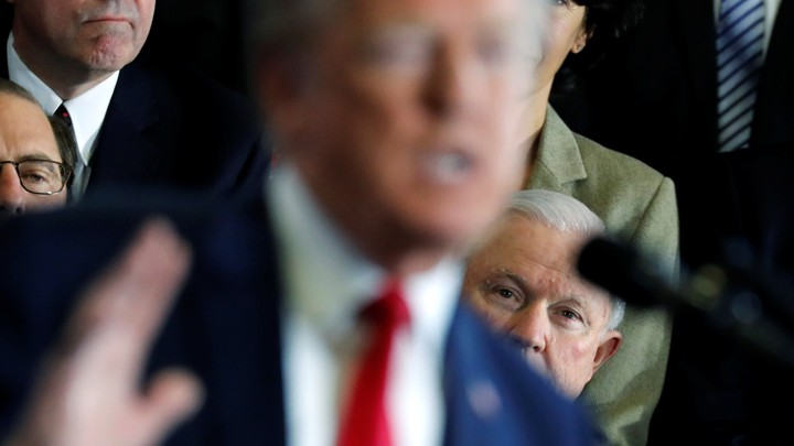 At a March 19 event in New Hampshire, Attorney General Jeff Sessions watches President Trump give a speech about the opioid epidemic.