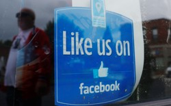 "A window advertisement that says ""Like us on Facebook"""