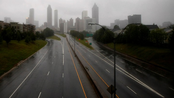 The city of Atlanta, seen through fog from a highway