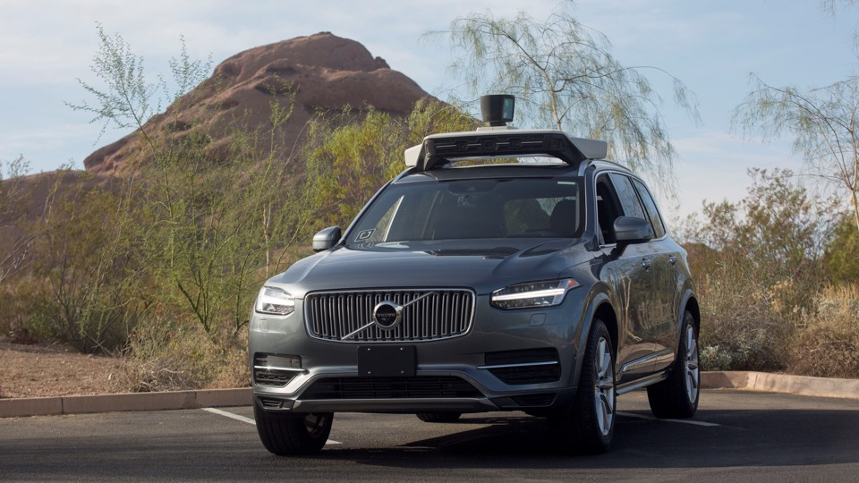 An autonomous SUV in a parking lot