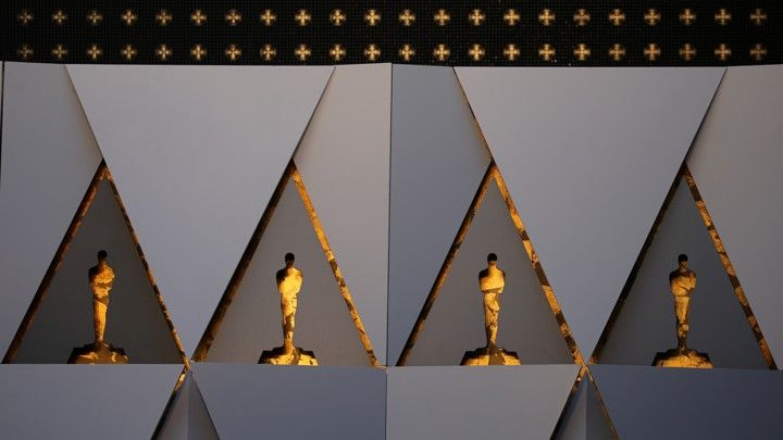 Gold painted Oscar cutouts are constructed as a background for arriving guests and nominees in preparations for the 90th Academy Awards in Hollywood, Los Angeles,