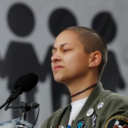 "Emma González, a student and shooting survivor from the Marjory Stoneman Douglas High School in Parkland, Florida, addressing the conclusion of the ""March for Our Lives"" event in Washington, D.C."