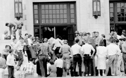Black students are escorted through the front door of Central High School in Little Rock, Ark., Sept. 26, 1957.