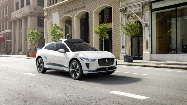 A white self-driving car on a road