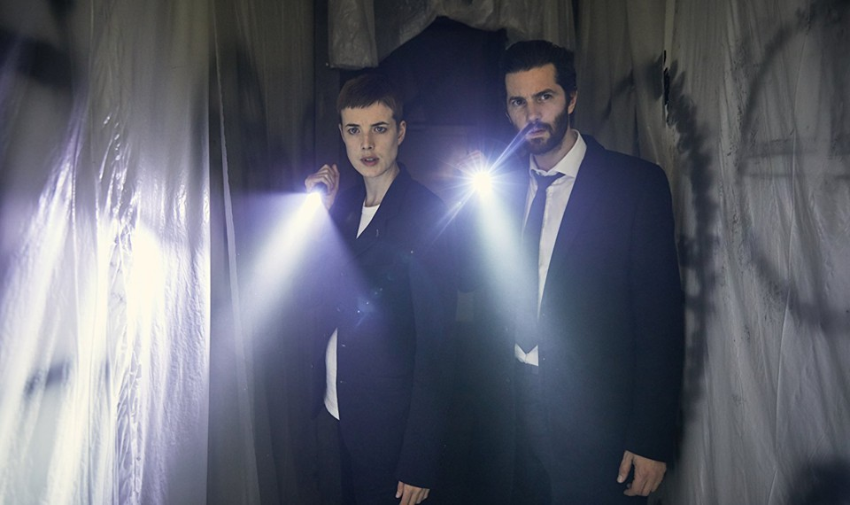 Agyness Deyn and Jim Sturgess with flashlights in a still from 'Hard Sun'