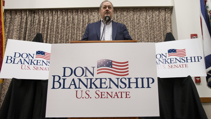 Don Blankenship, a Republican Senate candidate in West Virginia, surrounded by campaign signs.