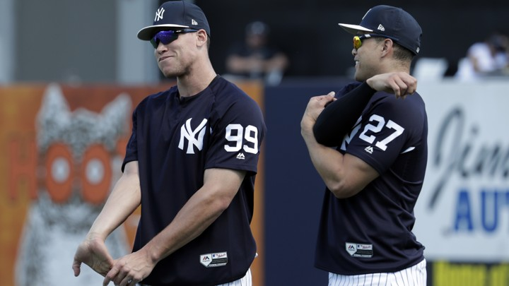 New York Yankees' Aaron Judge, left, and Giancarlo Stanton stretch at baseball spring training camp