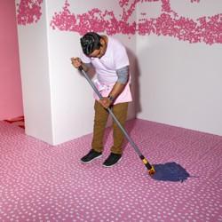 Museum of Ice Cream employee mopping the floor