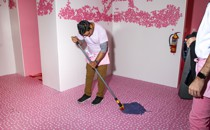 Museum of Ice Cream employee mopping the floor
