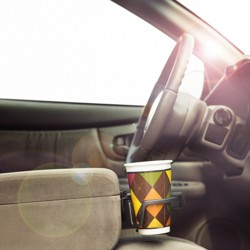An argyle-patterned cup in a center-console cupholder