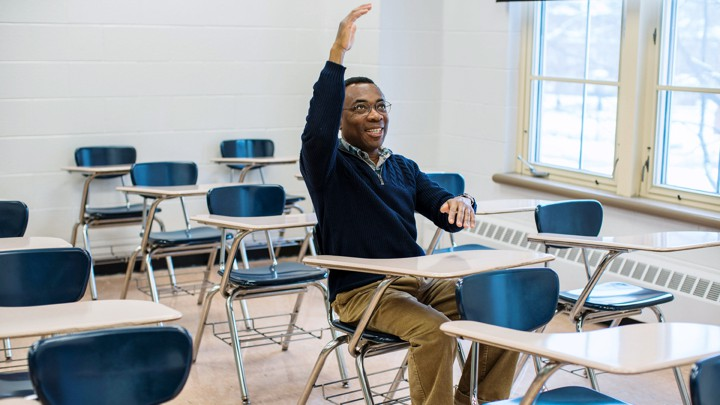 Donald Richards seated at a desk in a classroom