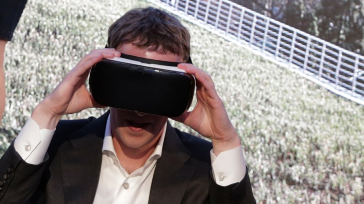 Mark Zuckerberg wears a pair of virtual-reality goggles.
