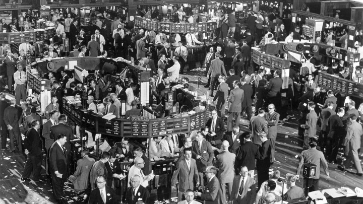 A 1948 black-and-white photograph of the New York Stock Exchange floor, filled with traders