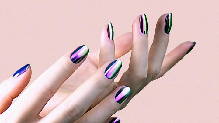 A person modeling chrome nail polish