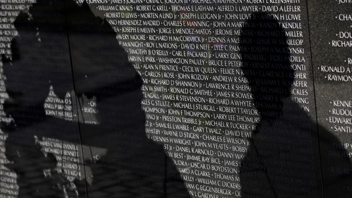 Visitors' shadows are seen cast on the Vietnam Veterans Memorial wall