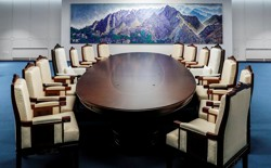 Chairs around a table with a painting of mountains in the background at the Peace House, the venue for the inter-Korean summit.