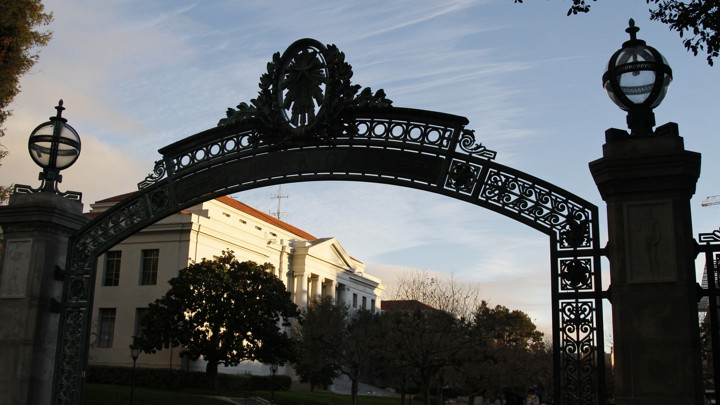 A silhouette of a UC campus gate