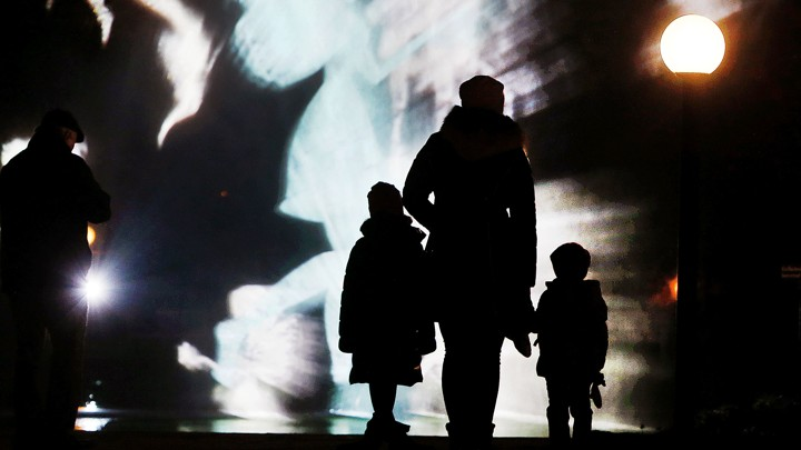 A family watches an art installation.
