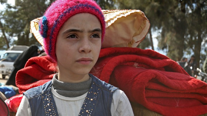 Syrian girl Noor, famous for broadcasting clips on social media about the regime-bombardments on the former rebel-held town of Jobar in Eastern Ghouta, arrives in Qalaat al-Madiq after being evacuated from Arbin on March 30, 2018.