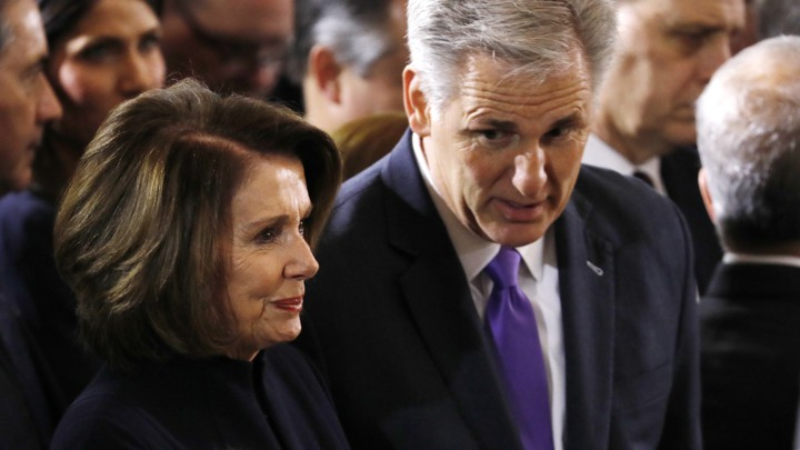House leaders Nancy Pelosi and Kevin McCarthy speak to one another.