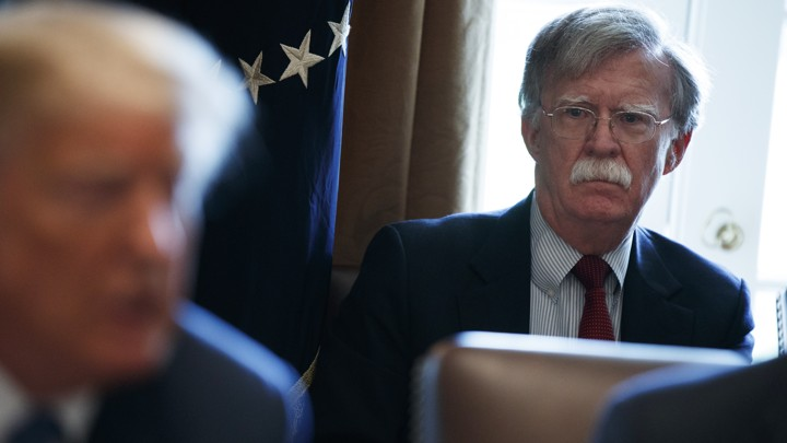 John Bolton looking at President Trump