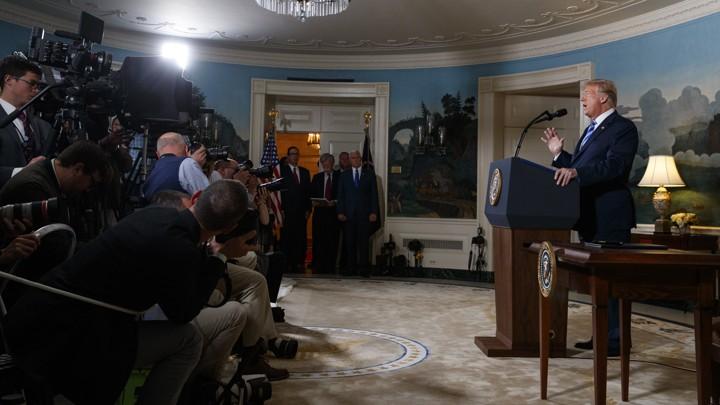 Camerapeople taping President Trump speaking