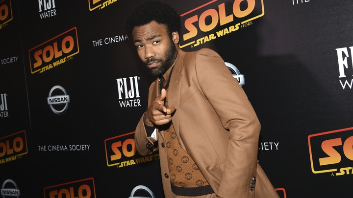 "Donald Glover points at a premiere event for ""Star Wars: Solo."""