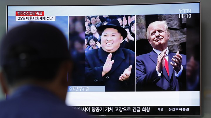 Kim and Trump on a TV screen