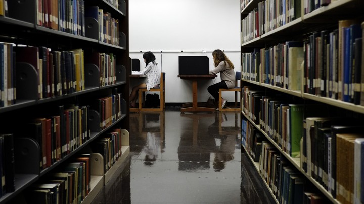 Students study in a library.