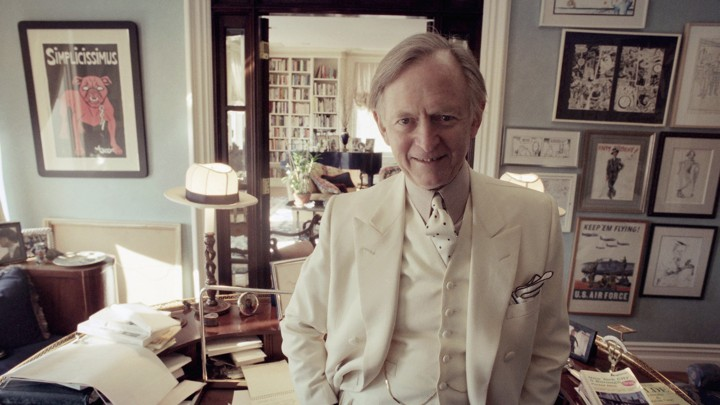 Tom Wolfe poses in his New York apartment in 1998