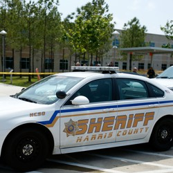 A Harris County sheriff car parked outside a school