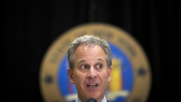 New York Attorney General Eric Schneiderman speaks at a microphone.
