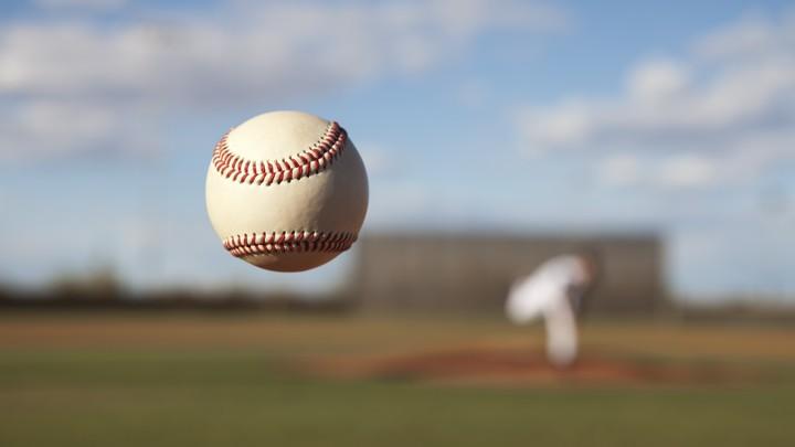 A pitcher throws a baseball