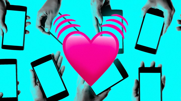 Hands holding smartphones with a beating heart emoji