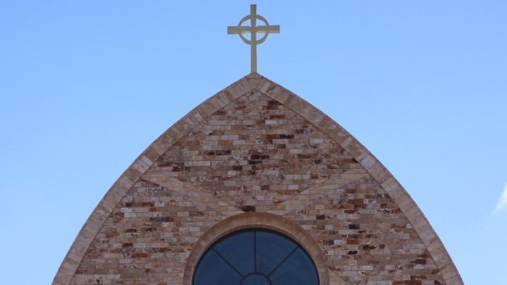 The cross atop Ave Maria Catholic Church, centrally located in Ave Maria, Florida, and across the street from Ave Maria University's academic buildings